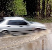 cars on flooded road bad weather poster
