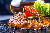 picture of chicken  - Steak chicken breast olive oil cherry tomatoes pepper and rosemary herbs - JPG