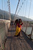 Indian Woman With Big Package On Ram Jhula Bridge
