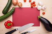 Cooking Items Arranged Around A Red Piece Of Paper
