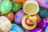 image of duck egg blue  - Multicolored easter egg toys with patterns showing a hatched egg - JPG
