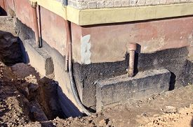 stock photo of foundation  - repair old urban house foundation work place - JPG