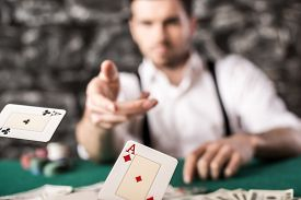 picture of suspenders  - Young confident gangster man in shirt and suspenders is throwing his cards on poker table while he - JPG