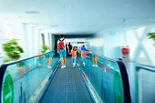 image of escalator  - father and son moving on escalator after arrival in international airport - JPG