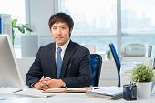 foto of korean  - Young Korean office worker at his workplace - JPG