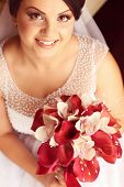 foto of calla  - Beautiful bride holding a white and red calla lily - JPG