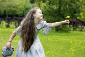 picture of polite girl  - Girl giving flowers to her imaginary friend - JPG