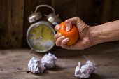 stock photo of stress-ball  - Hands of a woman squeezing a stress ball - JPG
