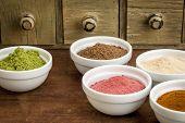 image of ceramic bowl  - super fruit and leaf powders in small ceramic bowls  - JPG