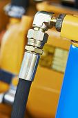 stock photo of hydraulics  - Hydraulic pressure pipes system of construction machinery - JPG