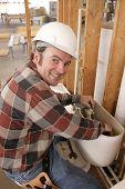 Plumber Repairs Toilet