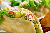 stock photo of tacos  - Tasty taco on plate close up - JPG
