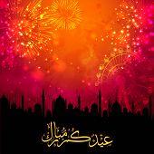 picture of eid mubarak  - Shiny golden arabic calligraphy text Eid Mubarak on mosque silhouette and fireworks background for muslim community festival celebration - JPG
