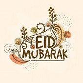 stock photo of ramazan mubarak  - Stylish text Eid Mubarak with floral design on beige background for muslim community festival celebration - JPG