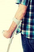 pic of crutch  - Young disabled man with crutches - JPG