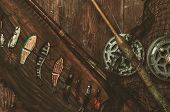 stock photo of fishing bobber  - Fishing tools on a wooden background - JPG