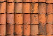 stock photo of gable-roof  - seamless orange roof tiles can be used as background - JPG