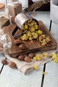 stock photo of roughage  - Dried herbs with nutmeg on table close up - JPG