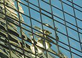 Chrysler Gargoyle Reflected In Hyatt Hotel In New York