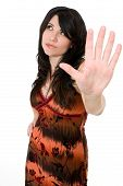 stock photo of headstrong  - A woman showing attitude such as conflict talk to the hand or say No concept - JPG