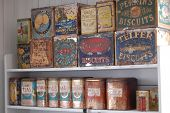 Brightly colored vintage food cans on