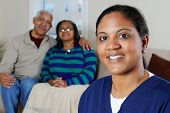pic of health-care  - Home health care worker and an elderly couple - JPG