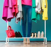 Woman Choosing Clothes To Wear In Mall Or Wardrobe poster