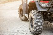 Close-up Tail View Of Atv Quad Bike. Dirty Whell Of Awd All-terrain Vehicle. Travel And Adventure Co poster