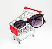 Metal Basket With A Glasses In It. Fashion Consumption, Shopping Concept. poster