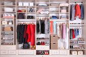 Large Wardrobe With Different Clothes, Home Stuff And Shoes poster