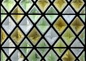 picture of stained glass  - diamond shaped pattern of a stained glass window - JPG