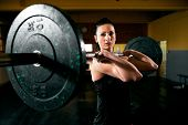 Exercise With Heavy Weight, Muscular Girl Holding Weights And Training Hard poster