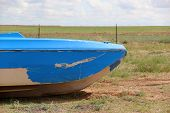 Blue Boat in Field