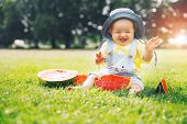 Baby Girl Eating Watermelon On Green Grass In Summertime On Nature poster