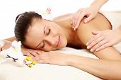 picture of spa massage  - A beautiful woman getting massage in a spa center - JPG