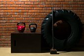 Equipment For Endurance Sports And Fitness Training On The Background Of A Red Brick Wall poster
