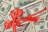 Money Gift Concept. Gift Of Money With Red Ribbon On Money American Hundred Dollar Bills. poster