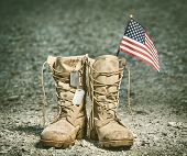 Old Military Combat Boots With The American Flag And Dog Tags. Rocky Gravel Background. Memorial Day poster