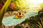 People Floating On Lazy River In Siam Park, Tenerife, Spain. poster