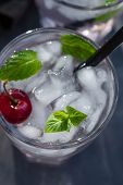 Cold Lemonade With Mint, Cherry And Ice. Chilled Drink. Top View. poster