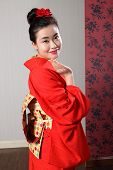 Greeting By Asian Woman In Japanese Kimono Robe