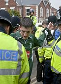 Plymouth Argyle Supporter being searched by Devon and Cornwall Police at a League 1 match