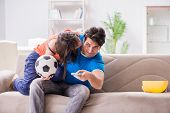 Wife unhappy that husband is watching football poster