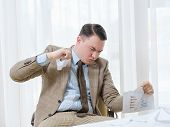 Angry Disappointed Business Man Tearing Documents To Pieces. Deal Failure Or Money Loss Concept poster