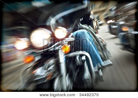 Abstract slow motion bikers riding