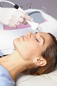 High frequency skin treatment in female face in spa