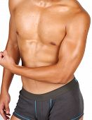 stock photo of bulging belly  - hunky asian flexing his muscles over white background - JPG