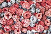 A Berry Mix From Frozen Raspberries And Blueberries. A Frozen Berries From Freezer.  A Sweet Backgro poster