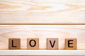 Love Made Of Wood Background. Love Concept. Love Sign, Emotions Concept. Word Love Made Of Wood Bloc poster