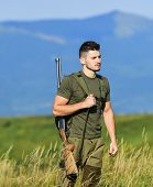 Man Observing Nature Background. Hunter Hold Rifle. Hunter Handsome Guy With Weapon. Brutal Masculin poster